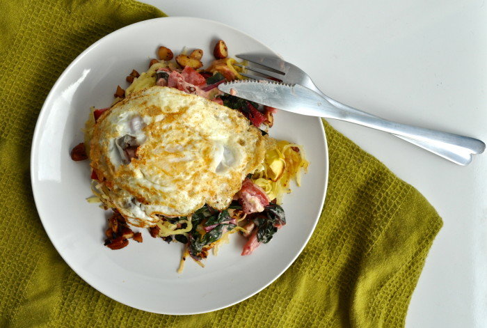 spaghetti squash, chard, spicy nuts, tahini tomatoes and fried egg stack