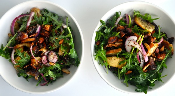 baby kale salad with dates, sumac almonds and red onion