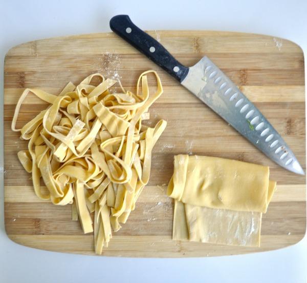 cutting pasta- tagliatelle