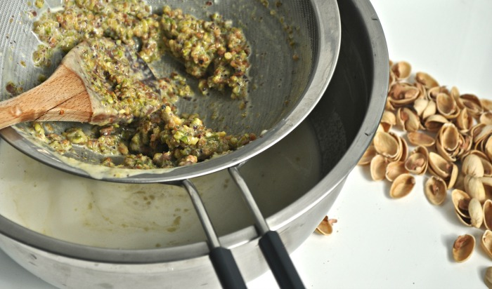 straining pistachio ice cream